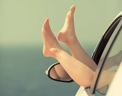 Feet out of a car window